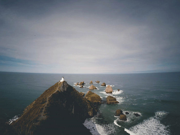 If you've ever thought about visiting New Zealand use these photos as a little bit of motivation. If they don't convince you to book the next flight to New Zealand then nothing will. Trust us....all of these sights are better in person! - Nugget Point North Island New Zealand