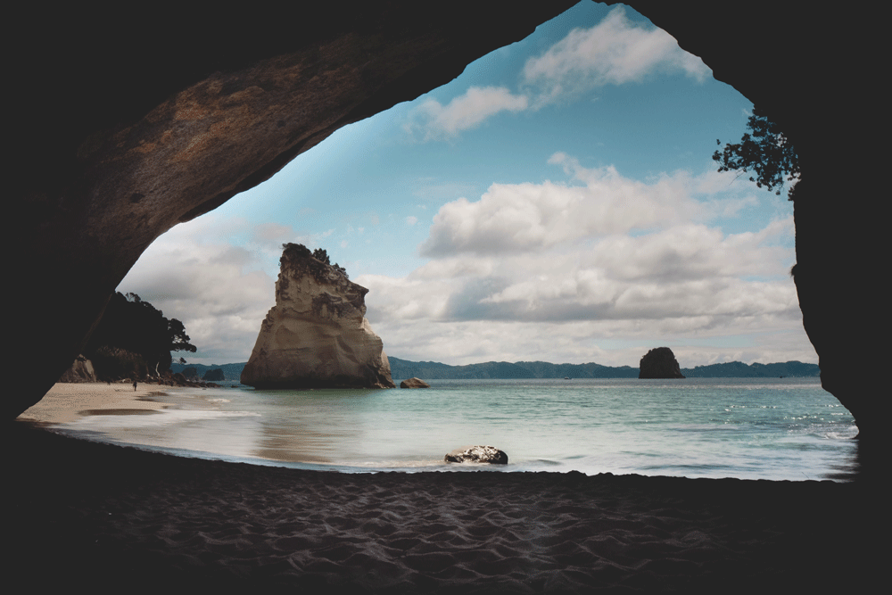 If you've ever thought about visiting New Zealand use these photos as a little bit of motivation. If they don't convince you to book the next flight to New Zealand then nothing will. Trust us....all of these sights are better in person! - Cathedral Cove North Island New Zealand